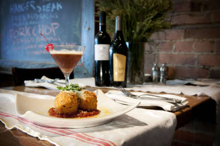 Stuffed Risotto balls, fried golden brown with a spicy tomato sauce