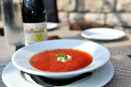 Red Borscht - Traditional soup with beets, root vegetables, finished with sour cream