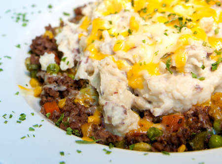 Shepherds Pie - Beef and a medley of veggies served under redskin mashed potatoes, topped with provolone, cheddar and mozzarella cheese  Imagens
