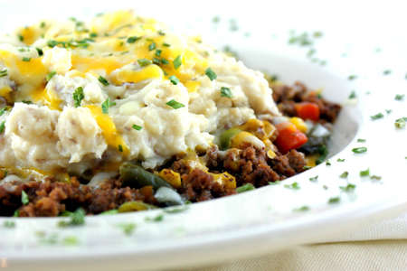british food: Shepherds Pie - Beef and a medley of veggies served under redskin mashed potatoes, topped with provolone, cheddar and mozzarella cheese  Stock Photo