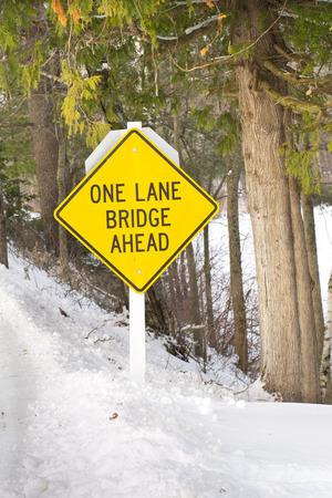 one lane sign: One Lane Bridge Sign Stock Photo