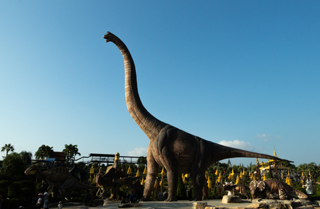 A Brachiosaurus model with blue sky in the Dinosaur valley, the Nongnuch zoo, Chonburi, Thailand.