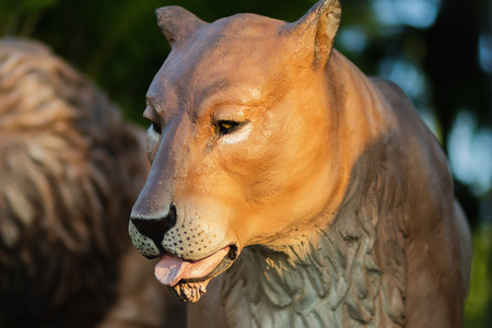 The lioness statue looks so tired with blurry background. Archivio Fotografico