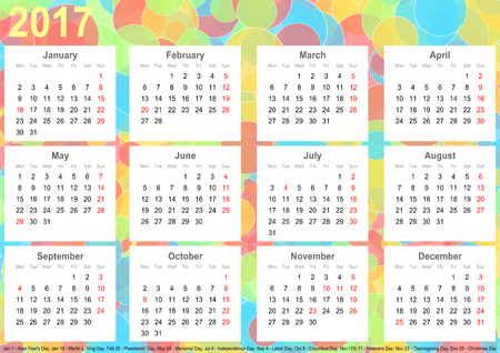 Calendar 2017 background with colorful circles, each month on white squares and with public holidays for the USA