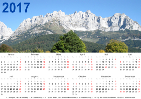 markings: Annual calendar 2017 with mountain landscape above and public holiday markings and listing below for Germany Stock Photo