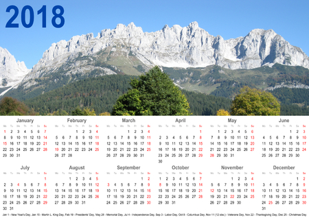Annual calendar 2018 with mountain landscape above and public holiday markings and listing below for USA