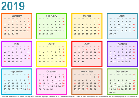 Calendar 2019, each month in a differently colored square and markings of public holidays for the USA in a landscape format