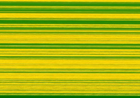 Green and yellow stripes in different widths in landscape format