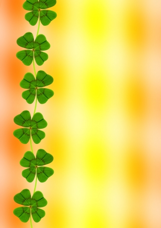 Four leaf clover in front of an abstract background photo
