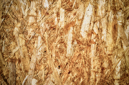 osb: A OSB wood panel with splintered structure