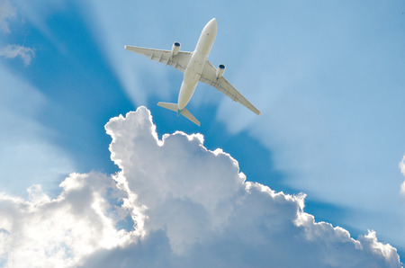 Plane during take off in front of clouds