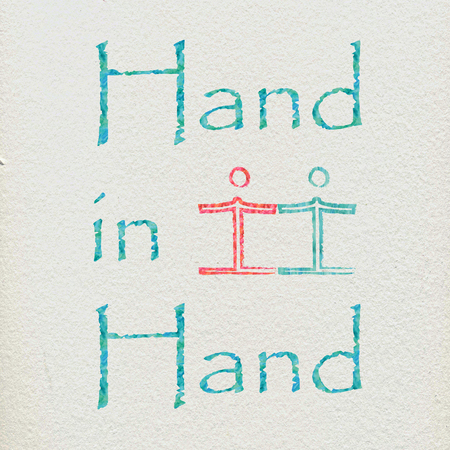 The words hand in hand and some figures holding hands