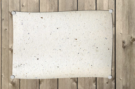 A paper tacked with stieckies on a wooden wall Standard-Bild