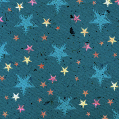 Christmas pattern with stars on handmade paper Standard-Bild