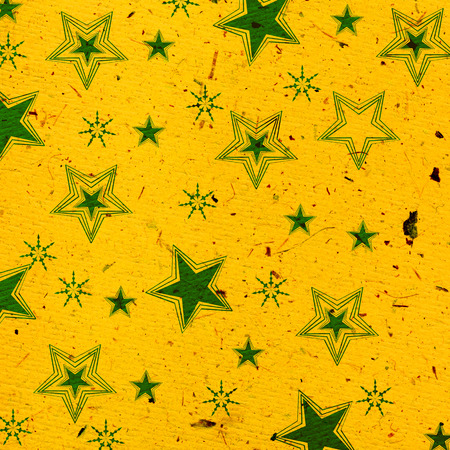 Christmas pattern with stars on handmade paper Stock Photo