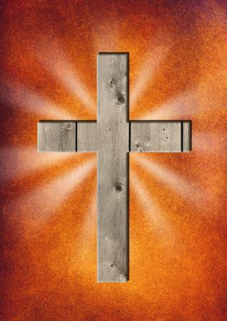 A wooden cross on an abstract background Standard-Bild