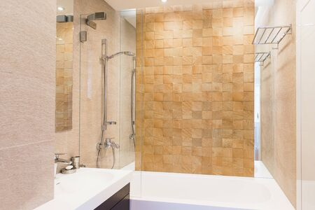 Iterior guest bathroom in warm tones. Interior and design, cleanliness and hygiene theme