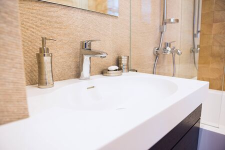 White sink and accessories in modern interior. Interior and design, cleanliness and hygiene theme