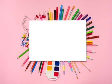Creative workspace on pink background, mockup, top view. Back to school, home art concept.