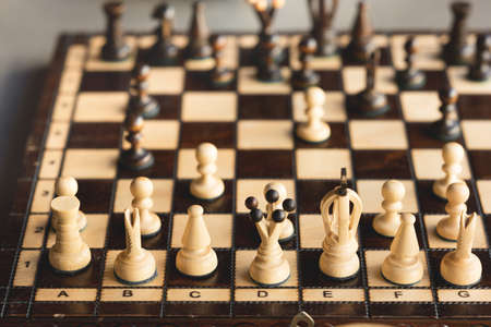 Wooden chess board and chess pieces on it. Intellectual board game, selective focus. Stock Photo