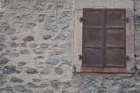 lattice window: Old metalic panjour and stone wall old design