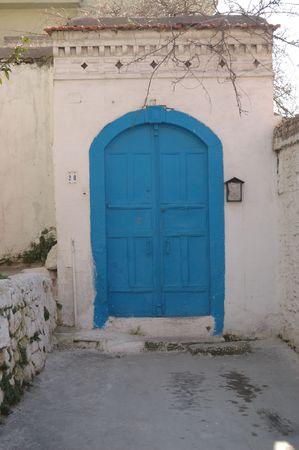 lattice window: Blue Door Old place white walls and road and door