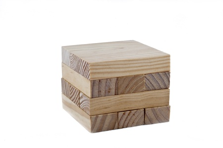 Wooden blocks make a cube on the white background