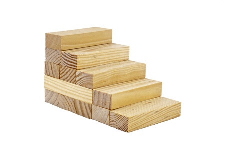 Wooden blocks  made by stairs in the white isolated background Stock Photo - 11808780