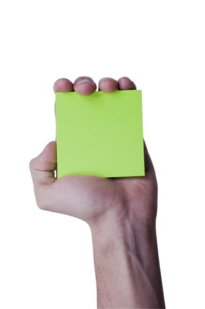 Green memo paper holding in the human hand Stock Photo - 12228628