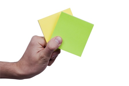 Yellow&Green memo paper holding in the human hand Stock Photo - 12228625
