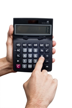 Human Hand Holding Calculator making some calculations photo
