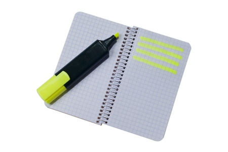 Spiral notepad with path highlighted on some rows with highlighter pen photo