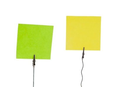 Green and Yellow papers in paper holders  using by for memo