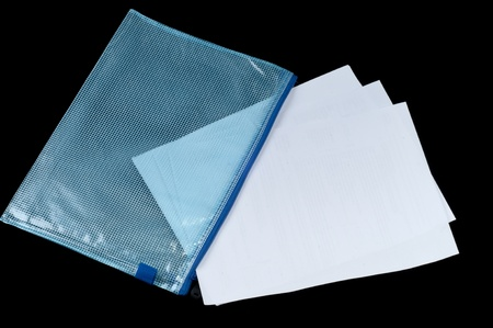 Some paper in the plastic checked envelope on isolated black background Stock Photo