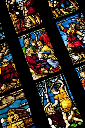Medievel stories on the colorful glass inside duomo cathedral Editorial