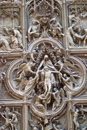 Statue of angels and marry  wall of duomo Cathedral in milano