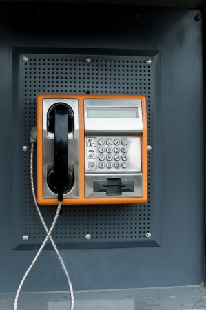 Orange Color Payphone using by call in bulgaria