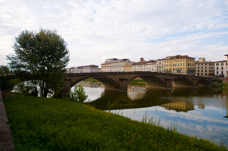 firenze: Old stone bridge on the firenze riveside is very historical panorama