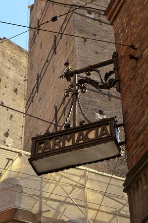 Old italian farmacia , pharmacy sign in street of the bologna ,italy