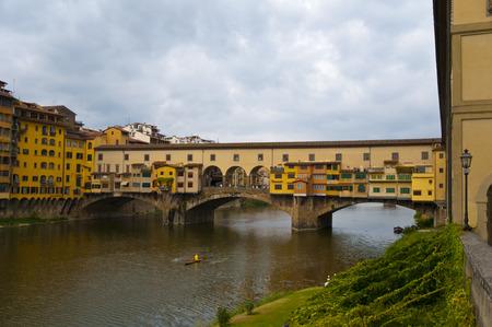 firenze: View of The Ponte Vecchio Old Bridge a Medieval stone closed-spandrel segmental arch bridge in Firenze ,italy