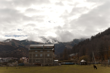 View of the Bakuriani mountains and some village hotels on Georgia Stock Photo