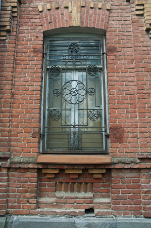 Iron Fence and Old brick wall windows on the street of tbilisi ,georgia