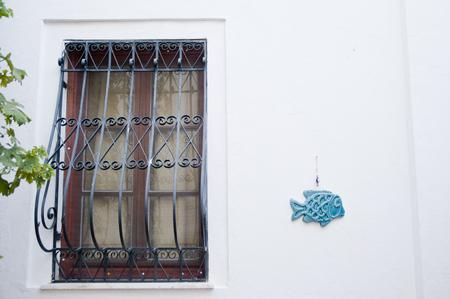 Fish Shape ceramic and Windows evil eye amulet decoritve art object in bodrum , turkey Stock Photo