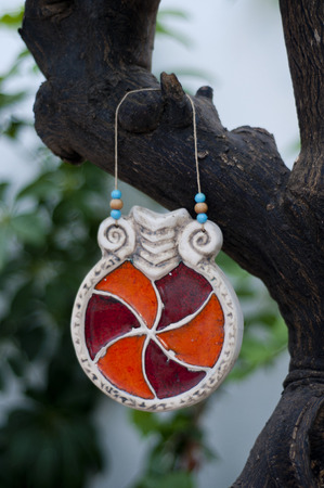 Old Twisted ceramic haning on the tree is traditional turkish culture objects