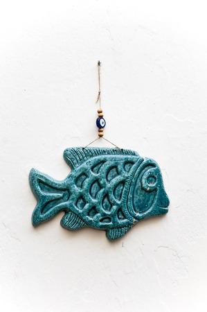 Fish Shape ceramic and evil eye amulet decoritve art object in bodrum , turkey Stock Photo