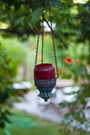 Old red Candle Hangin on tree  old  Crescent symbol in Bodrum Turkey Stock Photo
