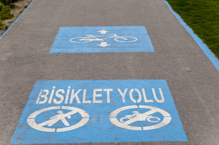Blue Bicycle Road sign on the Asphalt ground for marking in izmir Turkey