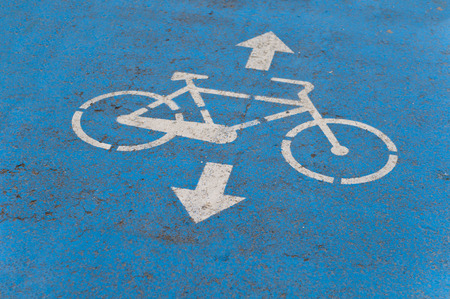 Blue Bicycle Road sign on the Asphalt ground for marking