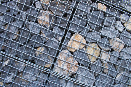 gabion mesh: Cage of the Rock piles for indistury using by texuted Stock Photo