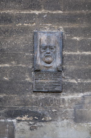 Memorial stone statue portait on the wall of the church , lviv ukraine Editorial